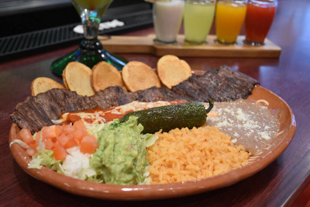 Tampiqueña - steak, served with a cheese enchilada, and topped with red sauce and even more cheese!