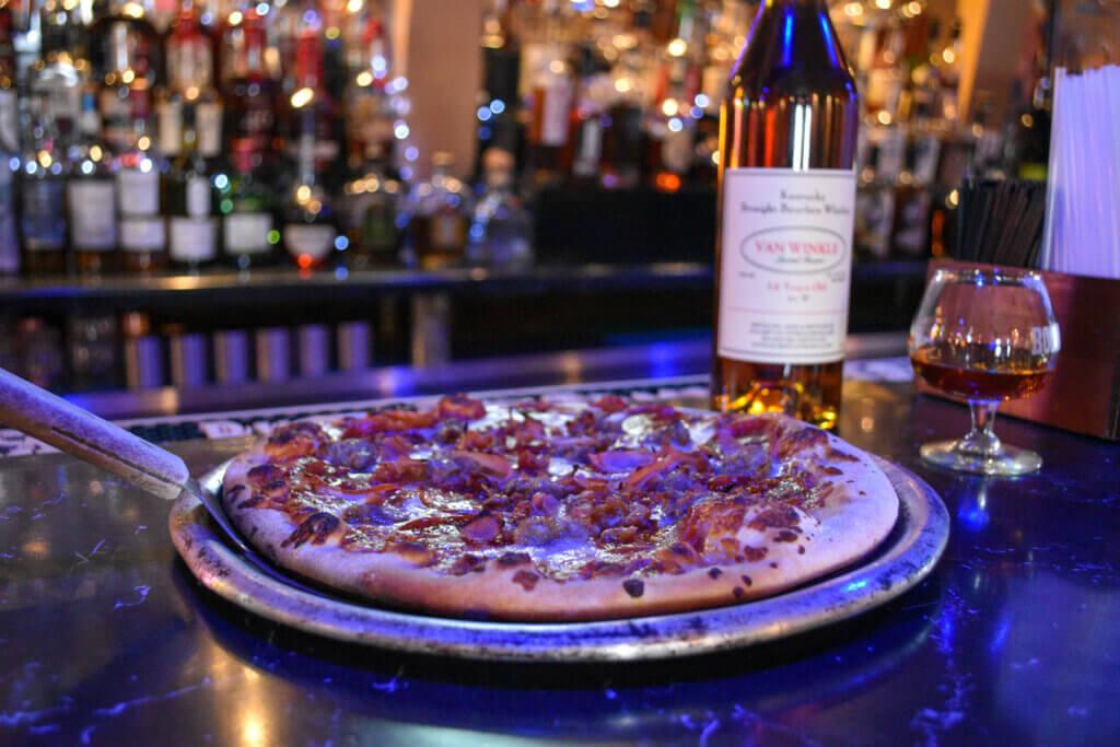 Homemade pizza at the bar.